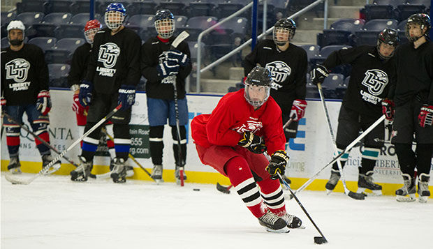 High school-aged players participate in drills Monday morning at the LaHaye Ice Center. test test test test