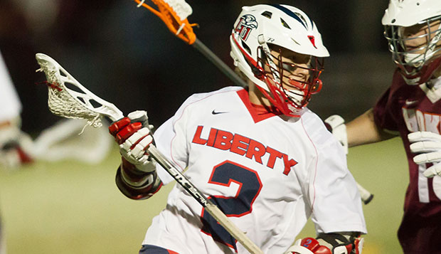 Liberty attackman Ryan Miller, who ranked fourth in MCLA Division I with 58 goals last season, battles against a Virginia Tech defender in the regular-season finale on April 18. test test test test