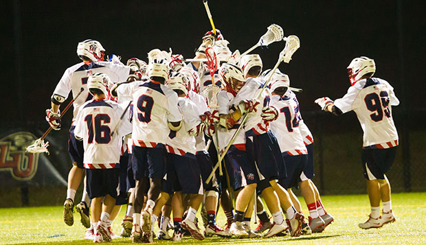 The Flames celebrate clinching the SELC Northwest Region regular-season crown with a victory over Virginia Tech on April 18, 2014, at the Liberty Lacrosse Field. test test test test