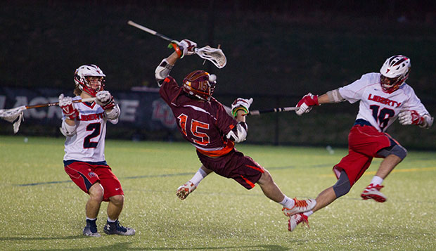 Freshman attack Sam Gregory (left) and sophomore attack Nick Lombardozzi double up on a Virginia Tech player during the Flames' 15-7 victory April 15 at the Liberty Lacrosse Field. test test test test