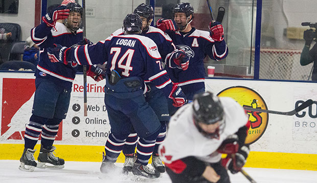 This season's alternate captains Bram Erickson (left) and Danny Logan and Ben Hughes (right), head captain this year, celebrate a goal during the Flames' sweep of Minot State in last year's regular-season finales at the LaHaye Ice Center. test test test test