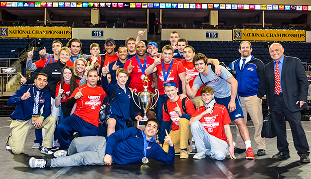 Liberty celebrates its first NCWA National Championship team trophy Saturday night at the Allen Event Center in Allen, Texas. (Photo courtesy of Sam Janicki) test test test test