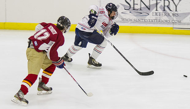 Liberty forward Peter Kazmierczak sprints past an Elon player to the puck during Friday night's 10-1 scorching of the Phoenix at the LaHaye Ice Center. test test test test