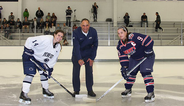 Liberty sophomore defender Rena Leone (right) prepares for the ceremonial puck drop before the start of Friday night's first game in Penn State's brand new Pegula Ice Arena. test test test test