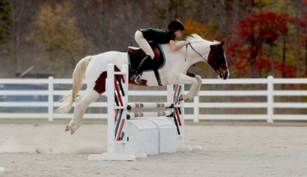 Lady Flames rider Emma Grace Moore jumps her horse