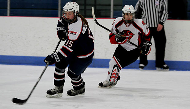 Liberty junior defenseman Autumn Kucharczyk skates with the puck in Friday's game at Davenport. test test test test