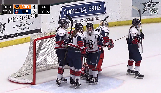The Lady Flames celebrate their ACHA National Championships first-round win over Midland, Wednesday night in Frisco, Texas. test test test test