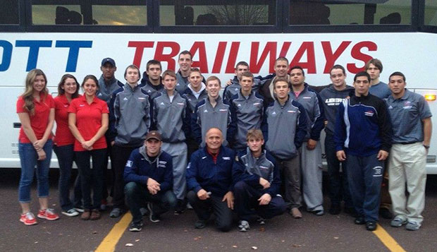 The 19 members of the wrestling team and their coaches and managers who traveled to Ursinus College for Saturday's Fall Brawl pose outside of their bus near Philadelphia. test test test test