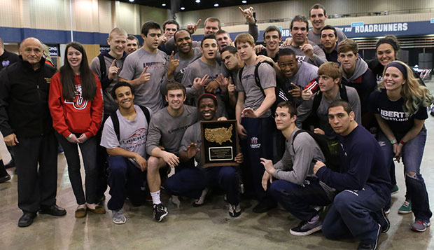 The Flames, including Head Coach Jesse Castro (left), show off the NCWA National Duals team trophy Saturday night at the Northwest Georgia Trade and Convention Center in Dalton, Ga. test test test test