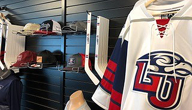 Liberty University hockey jerseys and hats are among the myriad merchandise available in the LaHaye Ice Center Pro Shop. test test test test