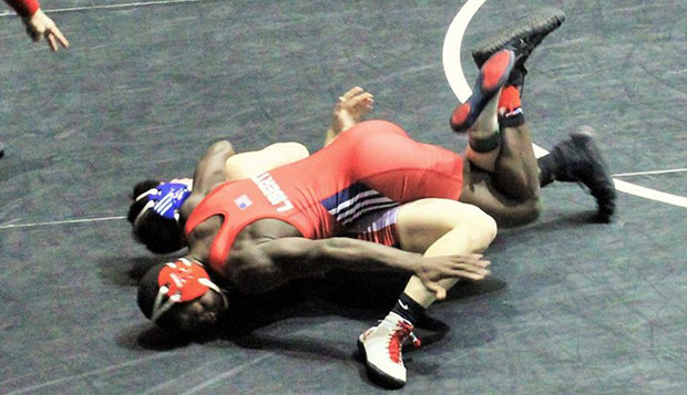 Liberty sophomore 141-pounder Logan Smith won both of his matches on Friday, pinning Penn State's TJ Nelson in the second bout. test test test test