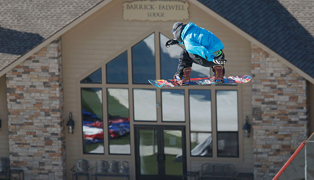 Louie Vito soars in front of the Barrick-Falwell Lodge on one of his Big Air jumps during Monday's visit to Liberty Mountain Snowflex Centre. test test test test