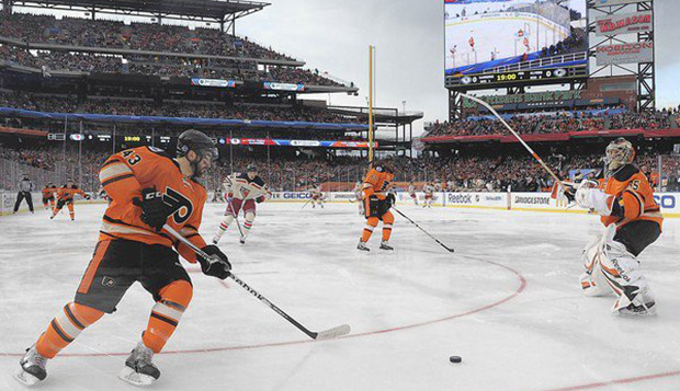 Marc-André Bourdon (left) handles the puck as a defenseman for the Philadelphia Flyers in the NHL's Winter Classic against the New York Rangers, played Jan. 2, 2012, at Citizens Bank Park in Philadelphia, home of Major League Baseball's Phillies. test test test test