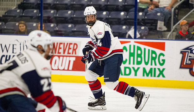 Liberty sophomore defenseman Matt Cruickshank skates against Syracuse at the LaHaye Ice Center. (Photo by Andrew Snyder) test test test test