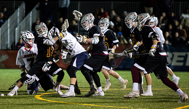 The Flames' attack runs into traffic  against No. 10 ASU on March 10 at the Liberty Lacrosse Field. (Photo by Andrew Snyder) test test test test