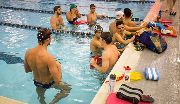Men's swimmers, including Thomas Sonnery-Cottet (right), take a break at the LaHaye Aquatics Center pool, which they practiced in last semester before moving into the new Liberty Natatorium last month. (Photo by Jessie Rogers) test test test test