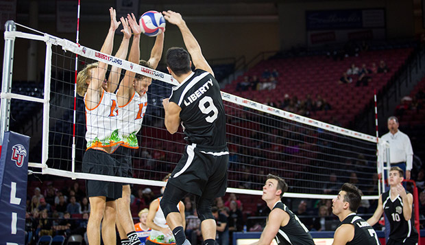 Florida, which competes in the ECVA Southeast, put up a solid block against the Flames all night in the annual 'Midnight Mayhem' match in the Vines Center. (Photos by Andrew Snyder)