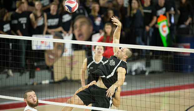 Liberty sophomore right-side hitter TJ Forsythe spikes over Virginia Tech setter Mitch Ford during Saturday's 'Midnight Mayhem' match in the Vines Center. test test test test