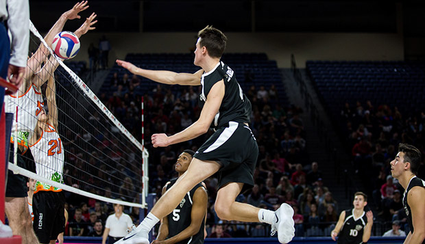 Sophomore outside hittter Sam Hess goes up for a spike into a Florida block in the Jan. 26 'Midnight Mayhem' match in the Vines Center. (Photo by Nathan Spencer) test test test test