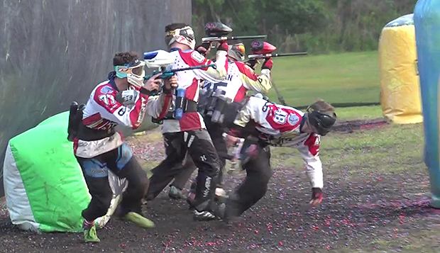Liberty's paintball team breaks out at the start of a point during a match at the national championships in Florida.  test test test test