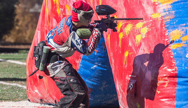 Sophomore Dorito side player Christian Campbell advances beside a bunker during the Flames' Class A tournament on Saturday at the Liberty Paintball Fields. test test test test