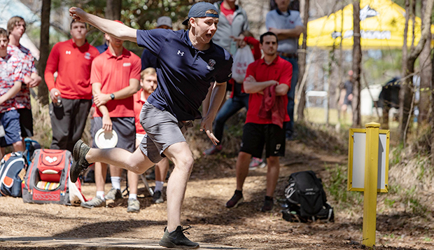 Pete Curran tees off at last spring's National Collegiate Disc Golf Championships, which qualified the Flames' top foursome for the Dean's Cup at the U.S. Disc Golf Nationals course. test test test test