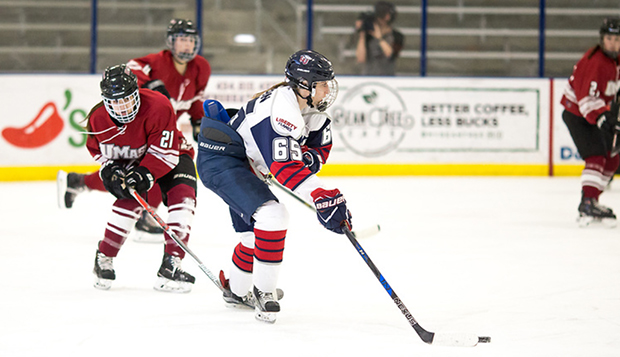 Lady Flames junior forward Rachel Gibson controls the puck in a recent game at the LaHaye Ice Center. (Photo by Joel Isimeme) test test test test