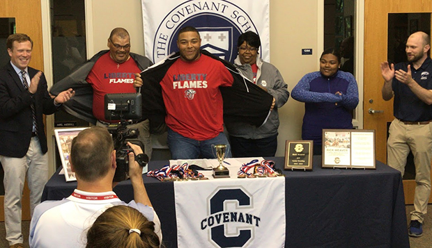 Rick Weaver reveals Liberty as his college choice during a signing ceremony at The Covenant School. (Submitted photo) test test test test