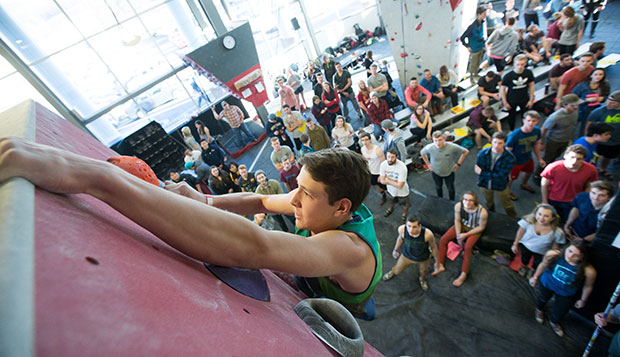 Liberty junior Mark Chauvette, one of 15 Flames team members, competes in last February's bouldering competition at the LaHaye Rock Wall. test test test test