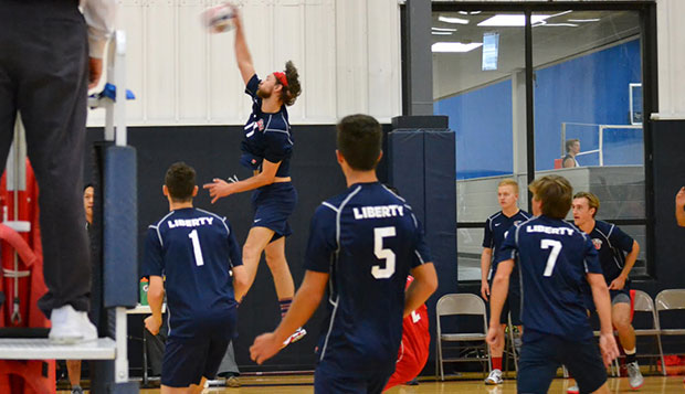 Senior right side hitter Sam Eisbrenner spikes in a match during Liberty's home tournament on Oct. 24. test test test test