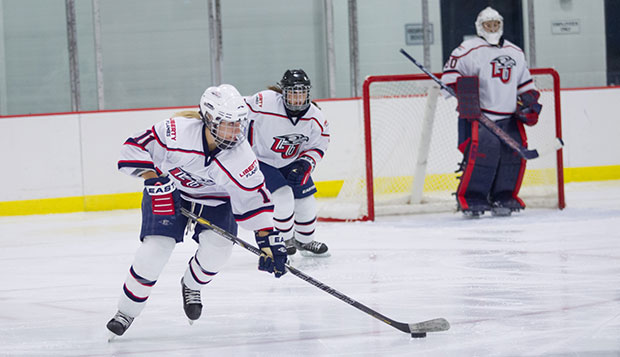 Liberty junior forward Sarah Stevenson (11) contributed three assists in the 3-3 tie with the Huskies, Friday night at Matthews Arena in downtown Boston. test test test test