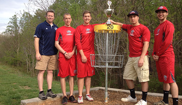 Liberty Head Coach Steve Bowman (left) poses with Tyler Andrick, Kyle Hoppe, Caleb Nicol, and Carson Dortch, the Flames' Second Flight team that won its division to earn a berth in next year's national championships.   test test test test