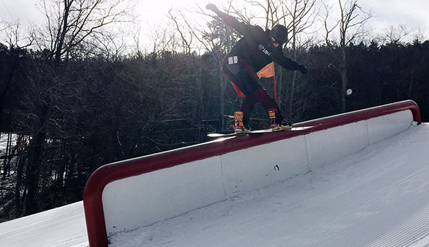 Liberty junior captain Brendan McHugh placed third in the men's snowboard Slopestyle event to lead the Flames to a first-place team USCSA East Coast Regional finish at Seven Springs. test test test test