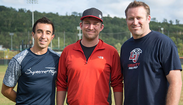 Head coach Steve Bowman (right) poses with professionals Paul McBeth (left) and Nate Sexton before they conducted a clinic on the South Campus Fields on Sept. 22, 2015.  test test test test