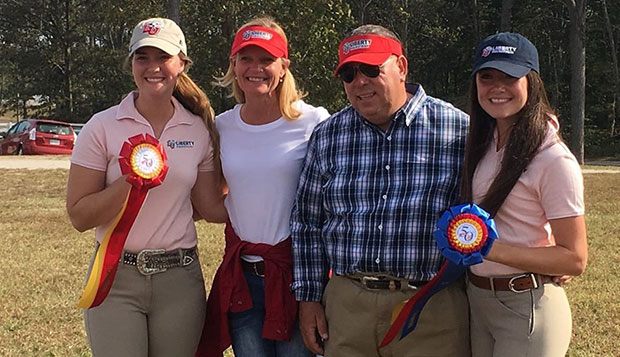 Liberty's new Associate Director of Equestrian Programs Suzanne Flaig (second from left) poses with Lady Flames freshman rider Amber Gayheart (left), Head Coach Jim Arrigon, and senior captain Liz Chenelle (right).  test test test test