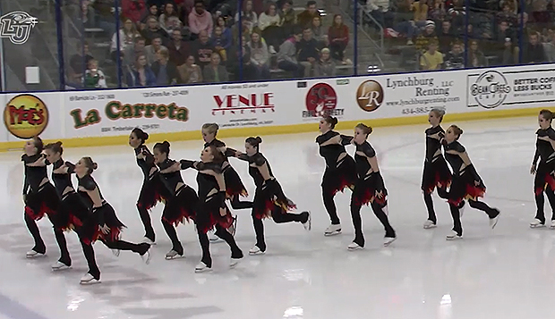 Liberty's synchronized skating team performed its routine at intermission of Friday's ACHA DI men's hockey game at the LaHaye Ice Center. test test test test