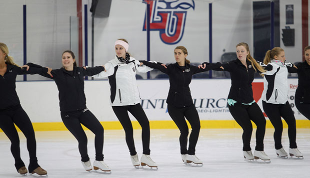 Liberty's synchronized skating team, which includes four members off the figure skating team, practices its routine Monday night in the LaHaye Ice Center. test test test test