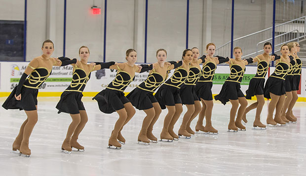 Members of the Lady Flames' synchronized skating team practice their 1920s Great Gatsby-themed routine in the LaHaye Ice Center. test test test test