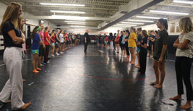 Liberty Head Coach Tom Childress (center) leads a group of 50 students in a self-defense seminar last Monday in the Wiseman Wrestling Room. test test test test