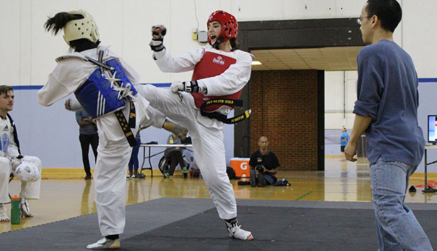 Moriah Martin, a sophomore from Alaska, was one of five champions at Saturday's Atlantic Collegiate Alliance of Taekwondo opener hosted by the University of North Carolina. (Photo courtesy Shannon Gallagher) test test test test