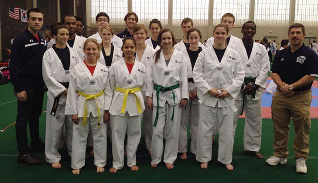 Liberty's tae kwon do team with assistant coach Brian Preiser (left) and head coach Jesse Wilson (right) after a Nov. 9 competition at Cornell University. test test test test