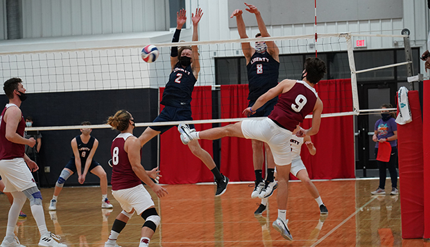 Sophomore middle hitter Tate Lapham (left) and senior outside hitter Sean Taggart go up for a block against SVU. test test test test