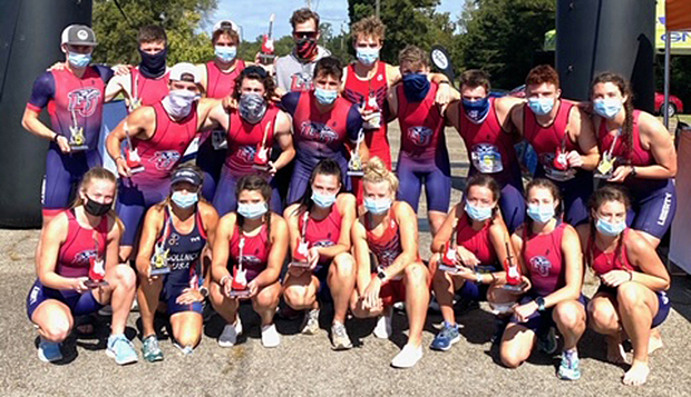 The Flames and Lady Flames pose with masks on at the finish line of the Oct. 18 Olympic distance race in Macon, Ga. test test test test