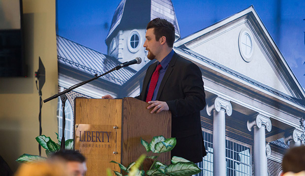 Liberty University Varsity Club Director Jake Hannon introduces the club at last year's athletic awards banquet in the Club Pavilion of the Williams Stadium Tower. test test test test