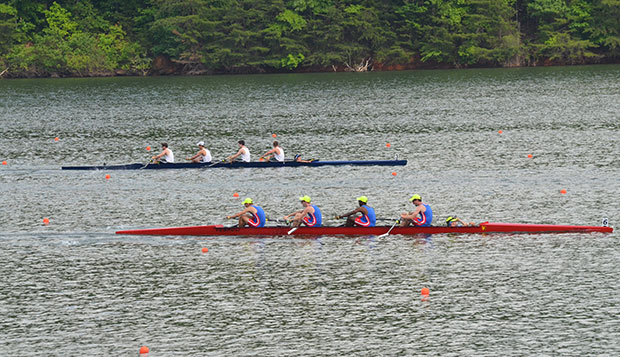 Members of Liberty's Varsity Men's Lightweight 4 (from left) sophomore captain and stroke seat Joel Buckhalt, senior Robert Newman, senior Mitchell Dieudonne, sophomore bow seat Sam Knauss, and coxswain Ron Beimel recorded a team-record time of 7 minutes, 1.6 on the Lake Lanier course in Sunday's final. test test test test