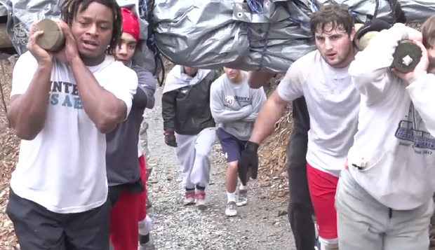 Liberty men's lacrosse players transport a makeshift sled weighed down with sand bags up Candlers Mountain, the crux of the two-day Warrior Fellowship survival/leadership training. test test test test