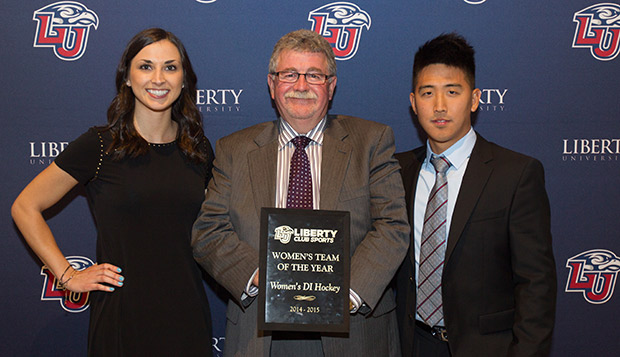 Liberty ACHA DI women's hockey assistant coaches Kaylee Vandjelovic (left) and Jonathan Chung (right), the Club Sports Assistant Coach of the Year, flank Head Coach Paul Bloomfield, holding the plaque for Female Team of the Year. test test test test
