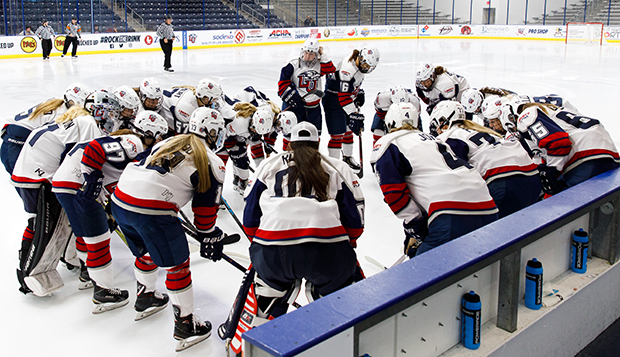 Senior goalie Nadia Rupoli (00) and the Lady Flames huddle before Friday's series opener. (Photos by Jenna McKenney) test test test test