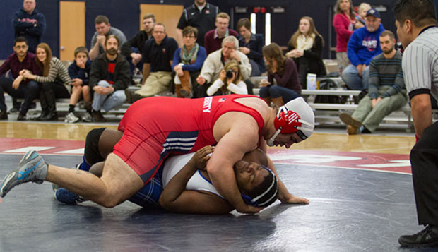Flames graduate heavyweight Josh Pelletier wrestles in a match against St. Andrews on Feb. 1 at the LaHaye Multipurpose Center. He decisioned Ferrum's Tate Dulany on Thursday, 8-3. test test test test