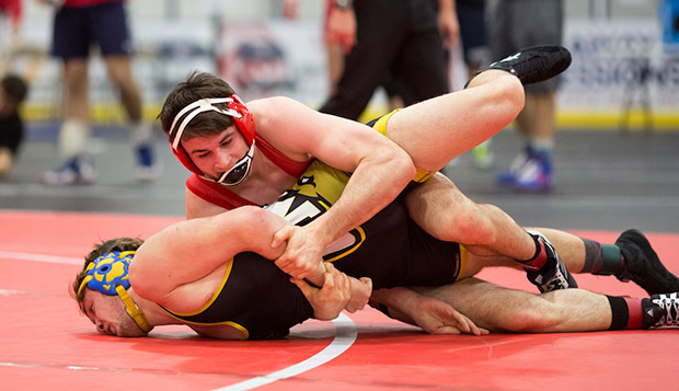 Liberty 165-pound freshman Luke Ely puts his UMBC opponent's face to the mat in Friday's action. (Photo by Nathan Spencer) test test test test